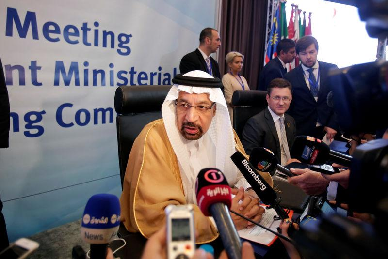 Saudi Arabian Energy Minister Khalid al-Falih talks to reporters at the OPEC Ministerial Monitoring Committee in Algiers