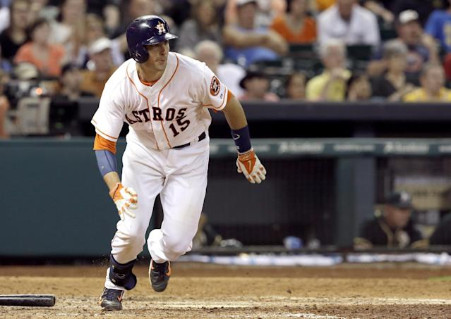 Houston Astros' Jason Castro heads up the first base line on an RBI-single against the Oakland Athletics in the eighth inning of a baseball game on Saturday, April 26, 2014, in Houston. (AP Photo/Pat Sullivan)