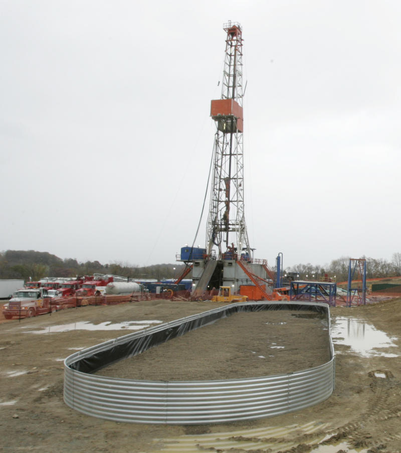 FILE -  In this Oct. 29, 2008 file photo, the drilling rig for a natural gas well into the Marcellus Shale is seen behind a foundation for equipment that remains on site after the well is tapped in Houston, Pa.  The Republicans' big Election Day victories in Pennsylvania and on Capitol Hill could mean an early Christmas for the drilling companies that are rushing to exploit the Marcellus Shale, one of the biggest known natural gas deposits in the nation. Republican Gov.-elect Tom Corbett is a lot friendlier to the industry than outgoing Democrat Ed Rendell. (AP Photo/Keith Srakocic, File)