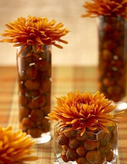 """<div class=""""caption-credit""""> Photo by: StyleCaster</div>Multiple floral accents can be a nice change as opposed to one large centerpiece. You can easily move the smaller arrangements around the table as food is added. The acorns here add a charming touch topped with flowers. <br> Image Via Celebrations"""