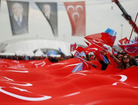 Supporters of Nationalist Movement Party (MHP) leader Devlet Bahceli carry a huge Turkish flag during a rally for the upcoming referendum, in Istanbul, Turkey. REUTERS/Osman Orsal