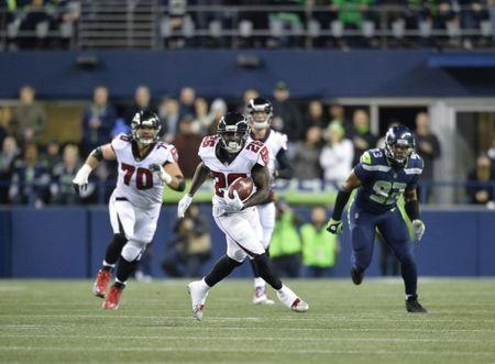 Nov 20, 2017; Seattle, WA, USA; Atlanta Falcons running back Tevin Coleman (26) carries the ball against the Seattle Seahawks during the first half at CenturyLink Field. Atlanta defeated Seattle 34-31. Steven Bisig-USA TODAY Sports