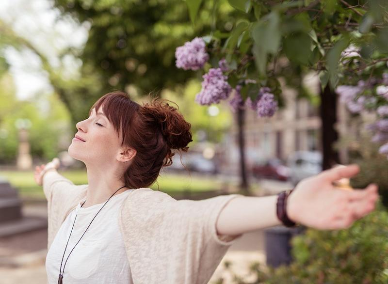 Happy woman with her arms outstretched