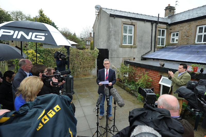 """Britain's Deputy House speaker Nigel Evans gives a press statement at his home in Pendleton, north west England, where he said Sunday May 5, 2013, that allegations him for rape and sexual assault are """"completely false.""""  Evans, 55, was arrested on Saturday. He was questioned about sex offenses that allegedly took place between July 2009 and March 2013 and was later released on bail. Evans — who has served in Parliament for two decades — says the allegations were made by """"two people well known to each other"""" and who until recently he had regarded as friends, even socializing with one accuser last week. (AP Photo/PA, Owen Humphreys)  UNITED KINGDOM OUT  NO SALES  NO ARCHIVE"""