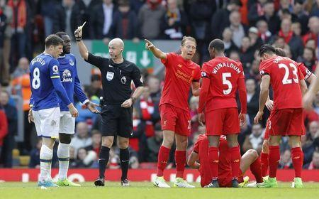 Britain Soccer Football - Liverpool v Everton - Premier League - Anfield - 1/4/17 Everton's Ross Barkley is shown a yellow card by referee Anthony Taylor as Liverpool's Dejan Lovren is on the floor Action Images via Reuters / Carl Recine Livepic