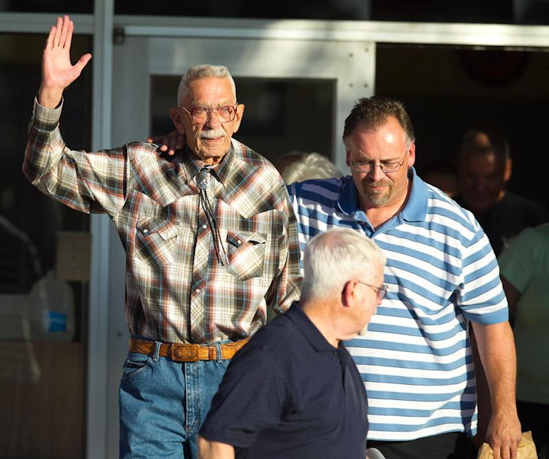 Bill Macumber waves after being released from prison, Wednesday, Nov. 7, 2012 at Superior Court in Phoenix. Macumber, a man imprisoned for nearly four decades for the killing of two 20-year-olds pleaded no contest Wednesday to second-degree murder charges in a move that secured his freedom. (AP Photo/The Arizona Republic, Michael Schennum)  MARICOPA COUNTY OUT; MAGS OUT; NO SALES