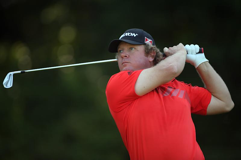 William McGirt of the US plays his tee shot on the seventh hole during the first round of the Wyndham Championship, at Sedgefield Country Club in Greensboro, North Carolina, on August 14, 2014 (AFP Photo/Darren Carroll)