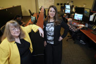 In this July 19, 2021, photo Amanda Crawford, right, and Nancy Rainosek, left, pose for a photo inside the state's Information Resources Command Center in Austin, Texas. (AP Photo/Chuck Burton)