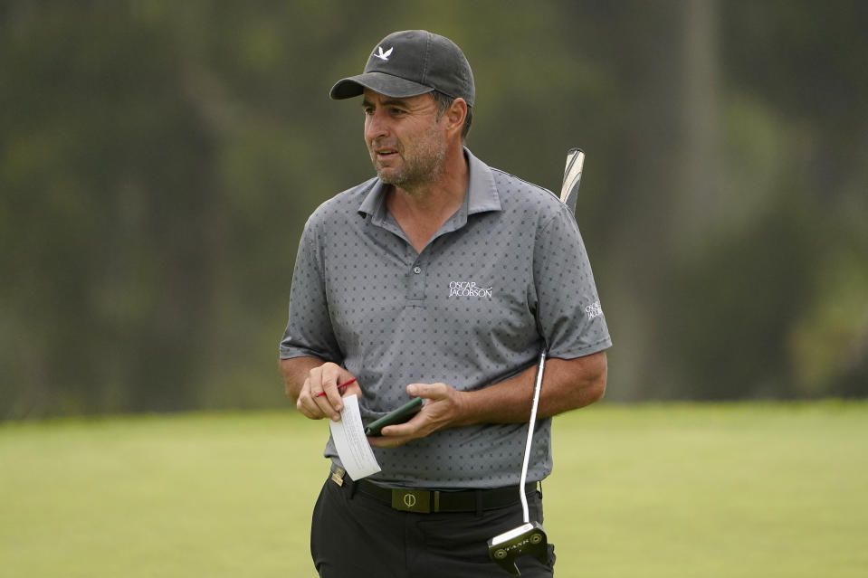 Richard Bland, of England, studies his shot on the 13th green during the second round of the U.S. Open Golf Championship, Friday, June 18, 2021, at Torrey Pines Golf Course in San Diego. (AP Photo/Jae C. Hong)
