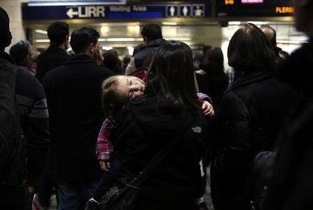 Travelers wait at Penn Station in New York, November 21, 2012, on the eve of Thanksgiving. REUTERS/Carlo Allegri