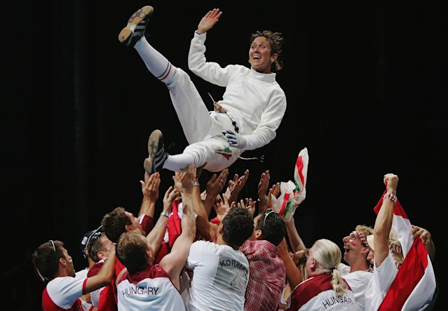 ATHENS - AUGUST 15: Timea Nagy of Hungary is thrown in the air to celebrate winning the gold medal in the women's fencing individual epee gold medal match on August 15, 2004 during the Athens 2004 Summer Olympic Games at Helliniko Olympic Complex Fencing Hall in Athens, Greece. (Photo by Jamie Squire/Getty Images)