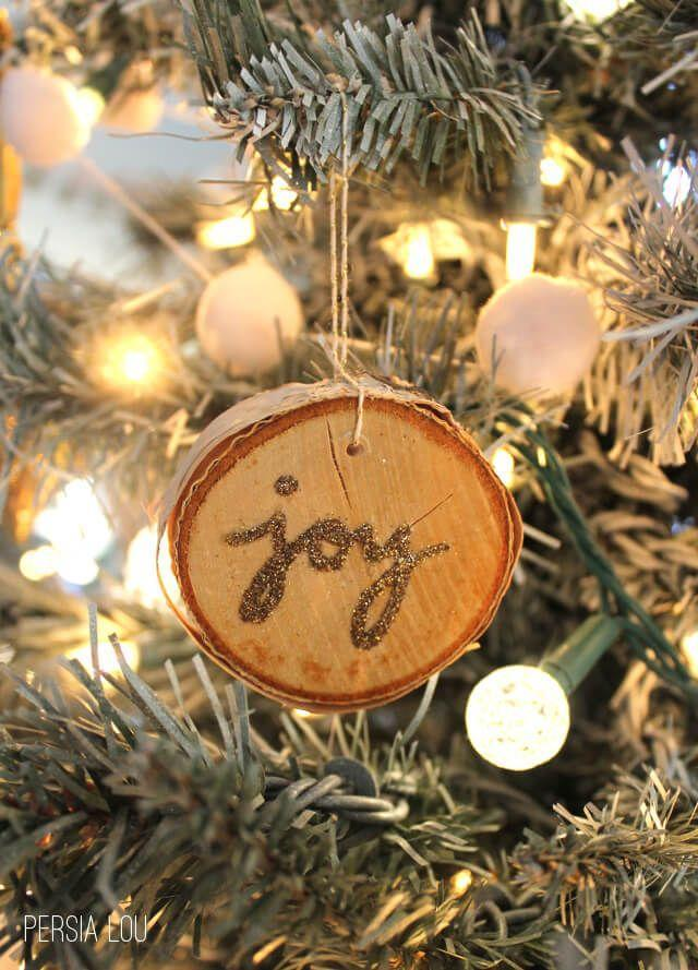 """<p>Combine birch wood slices, glitter, and Mod Podge and you've got a glam ornament that'll look great with the most rustic decor.</p><p><strong>Get the tutorial at <a href=""""https://persialou.com/glittery-wood-slice-ornaments/"""" rel=""""nofollow noopener"""" target=""""_blank"""" data-ylk=""""slk:Persia Lou"""" class=""""link rapid-noclick-resp"""">Persia Lou</a>. </strong></p><p><a class=""""link rapid-noclick-resp"""" href=""""https://www.amazon.com/Mod-Podge-Waterbase-16-Ounce-CS11302/dp/B001IKES5O?tag=syn-yahoo-20&ascsubtag=%5Bartid%7C10050.g.28831556%5Bsrc%7Cyahoo-us"""" rel=""""nofollow noopener"""" target=""""_blank"""" data-ylk=""""slk:SHOP MOD PODGE"""">SHOP MOD PODGE</a><br></p>"""