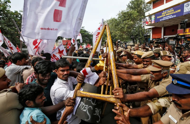 Police officers stop demonstrators during a protest against a new citizenship law, in Chennai