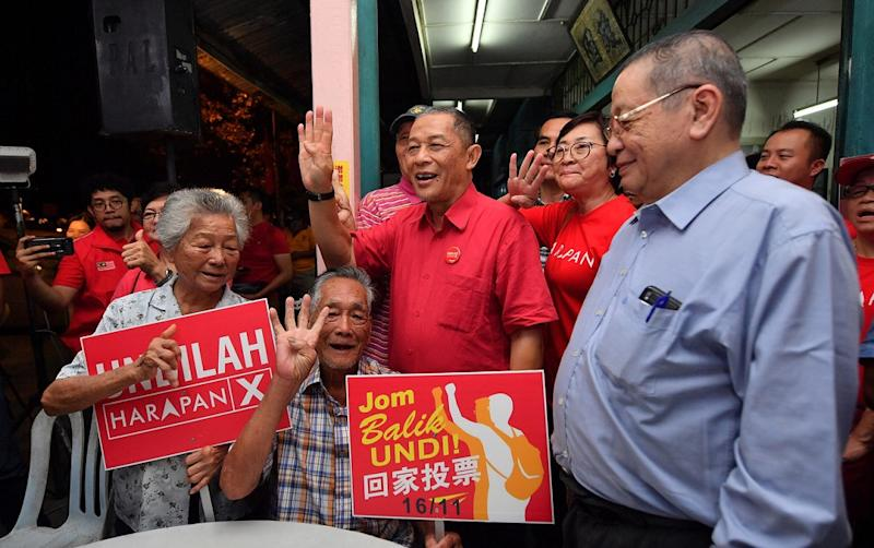 PH's candidate for the Tanjung Piai by-election Karmaine Sardini (centre) and DAP's Lim Kit Siang greeting some of the attendees at a forum in Kampung Penerok in Pontian November 6, 2019. — Bernama pic