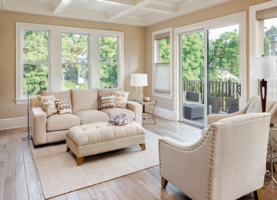 Beige couch in a smaller living room