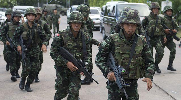Thai soldiers patrol after army chief General Prayut Chan-O-Cha met with anti-government and pro-government leaders at the Army Club in Bangkok. Credit: AFP