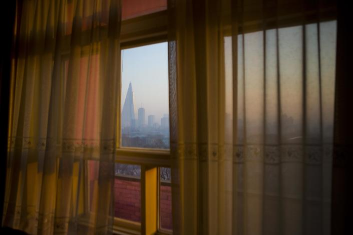 In this Feb. 21, 2013 photo, the 105-story Ryugyong Hotel is seen through the curtained window of the Potonggang Hotel in Pyongyang, North Korea. (AP Photo/David Guttenfelder)