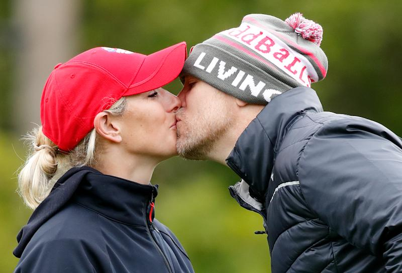 SUTTON COLDFIELD, UNITED KINGDOM - MAY 17: (EMBARGOED FOR PUBLICATION IN UK NEWSPAPERS UNTIL 24 HOURS AFTER CREATE DATE AND TIME) Zara Tindall and Mike Tindall kiss as they attend the ISPS Handa Mike Tindall Celebrity Golf Classic at The Belfry on May 17, 2019 in Sutton Coldfield, England. (Photo by Max Mumby/Indigo/Getty Images)
