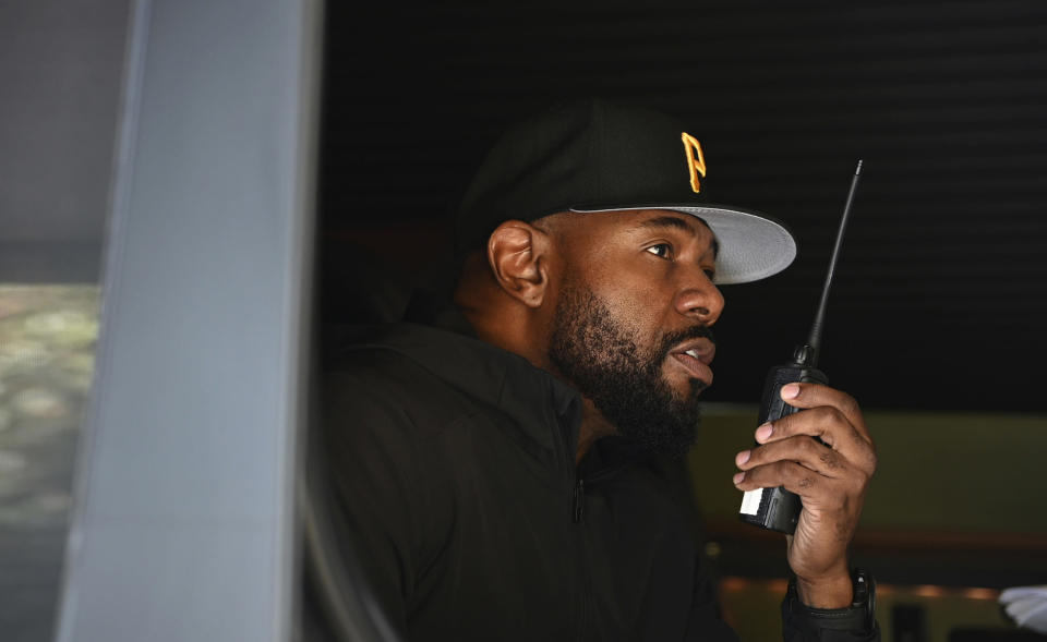 """This image released by Netflix shows director Antoine Fuqua working from a vehicle on the set of """"The Guilty."""" (Glen Wilson/Netflix via AP)"""