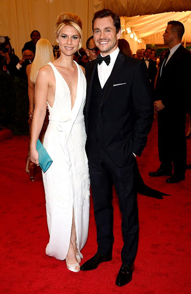 Claire Danes was the guest of J. Mendel – and she wore a low-cut asymmetrical white gown from his Fall 2012 collection – but she brought along her Prada-clad husband Hugh Dancy as her date.