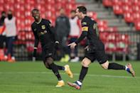 Lionel Messi celebrates with Ousmane Dembele after scoring one of his two goals in Barcelona's 4-0 win at Granada
