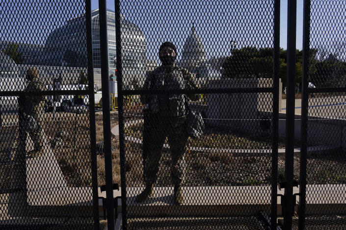 National Guard stand guard at a perimeter fence at the Capitol in Washington, Thursday, March 4, 2021. (AP Photo/Carolyn Kaster)