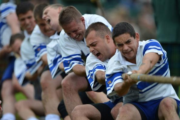 Tug of War team competes during the Braemar Highland Games at The Princess Royal and Duke of Fife Memorial Park on September 1, 2012 in Braemar, Scotland. The Braemar Gathering is the most famous of the Highland Games and is known worldwide. Each year thousands of visitors descend on this small Scottish village on the first Saturday in September to watch one of the more colorful Scottish traditions. The Gathering has a long history and in its modern form it stretches back nearly 200 years. (Photo by Jeff J Mitchell/Getty Images)