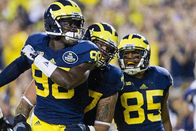 Michigan quarterback Devin Gardner (98) celebrates his rushing touchdown with offensive lineman Taylor Lewan, middle, and wide receiver Joe Reynolds (85) in the second quarter of an NCAA college football game with Notre Dame, in Ann Arbor, Mich., Saturday, Sept. 7, 2013. (AP Photo/Tony Ding)
