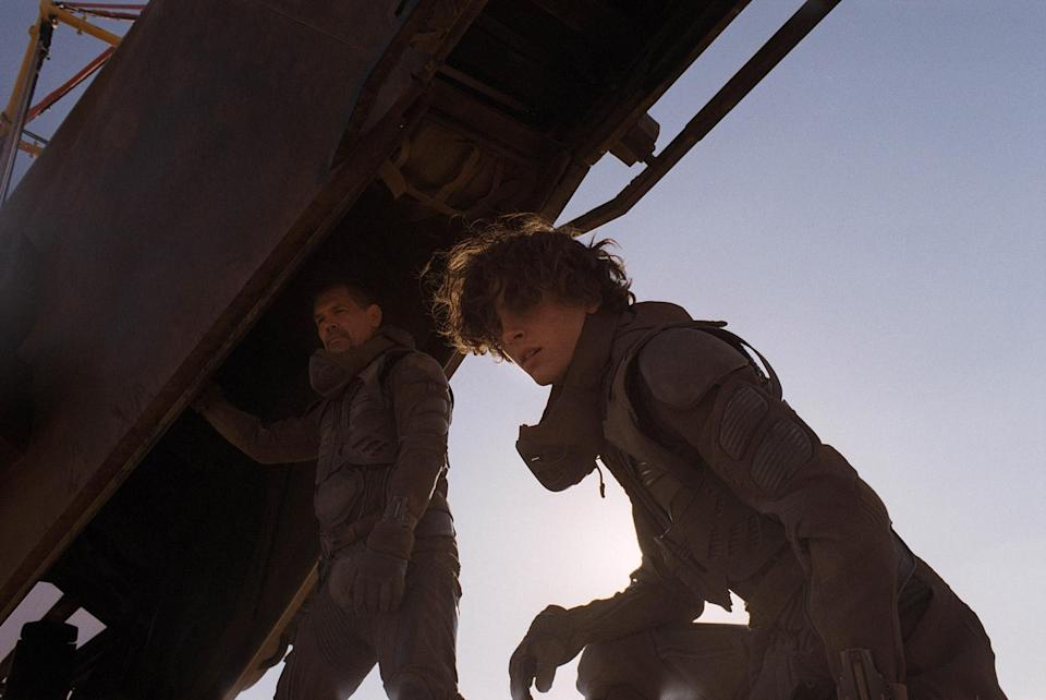 """<p>Fraser says he and Villeneuve looked at lots of films set in deserts in preparation for <em>Dune</em> — so that they could do something different. </p> <p>""""We deliberately went against the idea of blue sky and yellow sand. We wanted to create a white sky and white sand,"""" Fraser says. """"It's important for us to feel the hostility of this new planet. It's important that the camera, the visuals, and the colors make us feel like this is a waterless world."""" </p> <p><em>Pictured: Josh Brolin (Gurney Halleck) and Timothée Chalamet (Paul Atreides)</em></p>"""