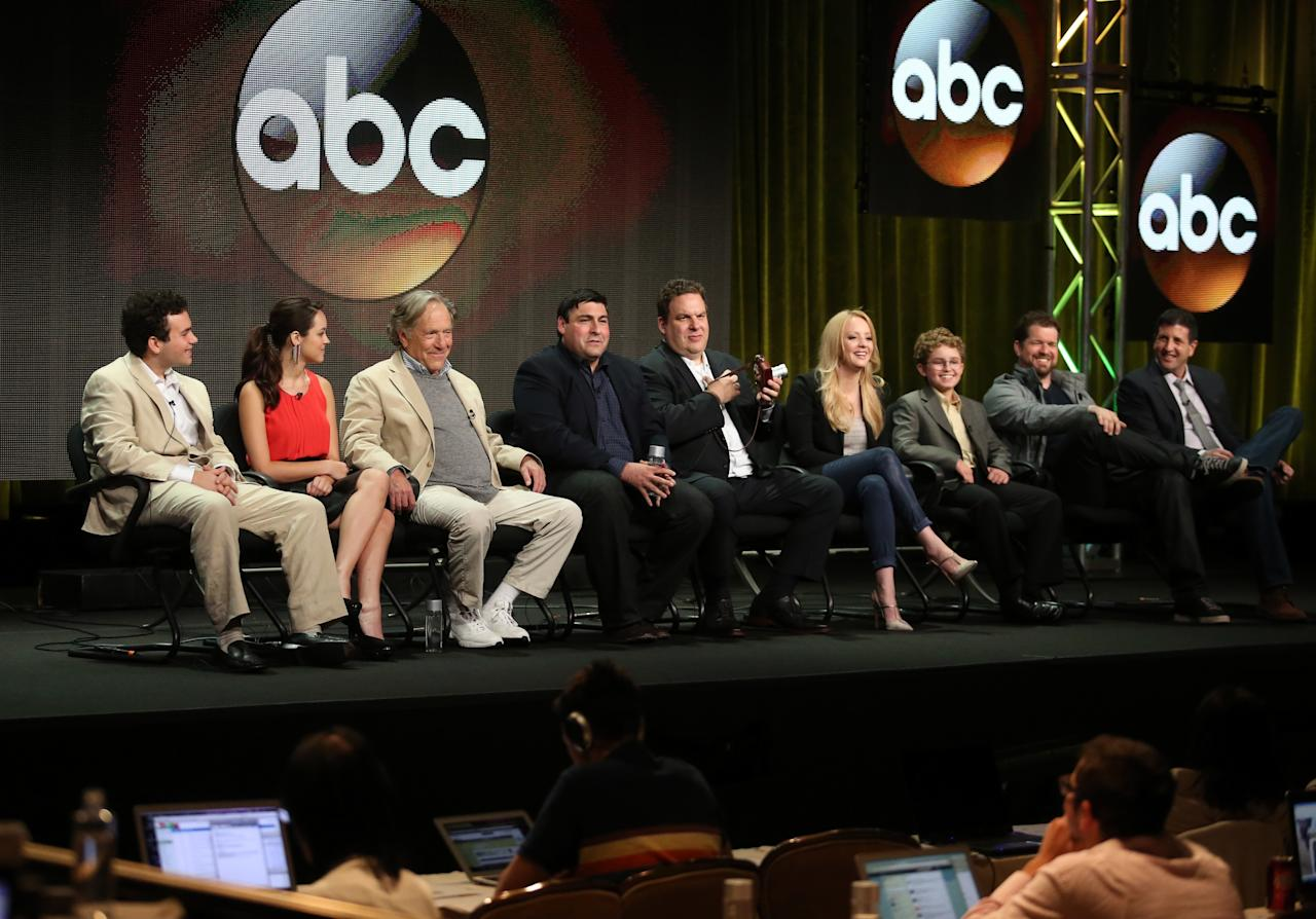 "BEVERLY HILLS, CA - AUGUST 04: Actors Troy Gentile, Hayley Orrantia, George Segal, writer/executive producer Adam F. Goldberg, actors Jeff Garlin, Wendi McLendon-Covey, Sean Giambrone, executive producers Seth Gordon, and Doug Robinson speak onstage during the ""The Goldbergs"" panel discussion at the Disney/ABC Television Group portion of the Television Critics Association Summer Press Tour at the Beverly Hilton Hotel on August 4, 2013 in Beverly Hills, California. (Photo by Frederick M. Brown/Getty Images)"