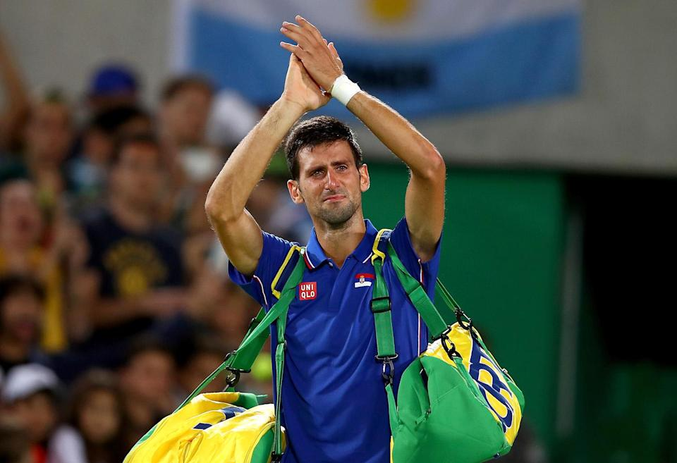 <p>Novak Djokovic of Serbia shows his emotion as he waves to the crowd after his defeat against Juan Martin Del Potro of Argentina in their singles match on Day 2 of the Rio 2016 Olympic Games at the Olympic Tennis Centre on August 7, 2016 in Rio de Janeiro, Brazil. (Photo by Clive Brunskill/Getty Images) </p>
