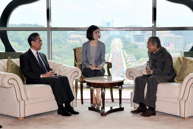 Prime Minister Tun Dr Mahathir Mohamad meets China's top diplomat Wang Yi (left) at his office in Putrajaya August 1, 2018. — Bernama pic