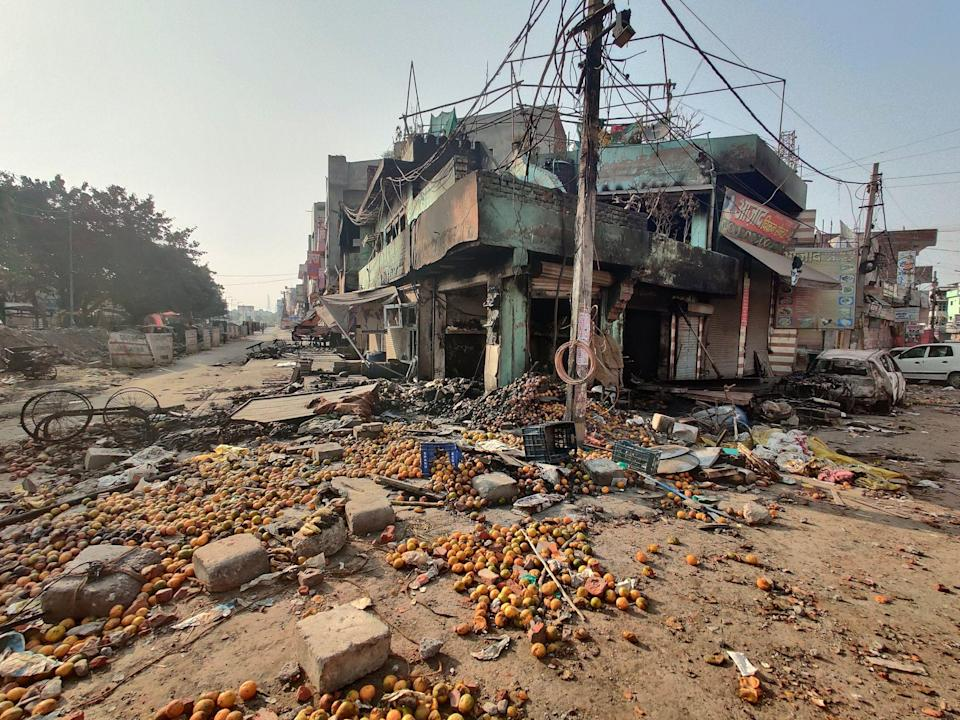 """<div class=""""paragraphs""""><p>A shop, and a home above it, in Chandbagh a day after it was burnt on 26 February last year.</p></div>"""
