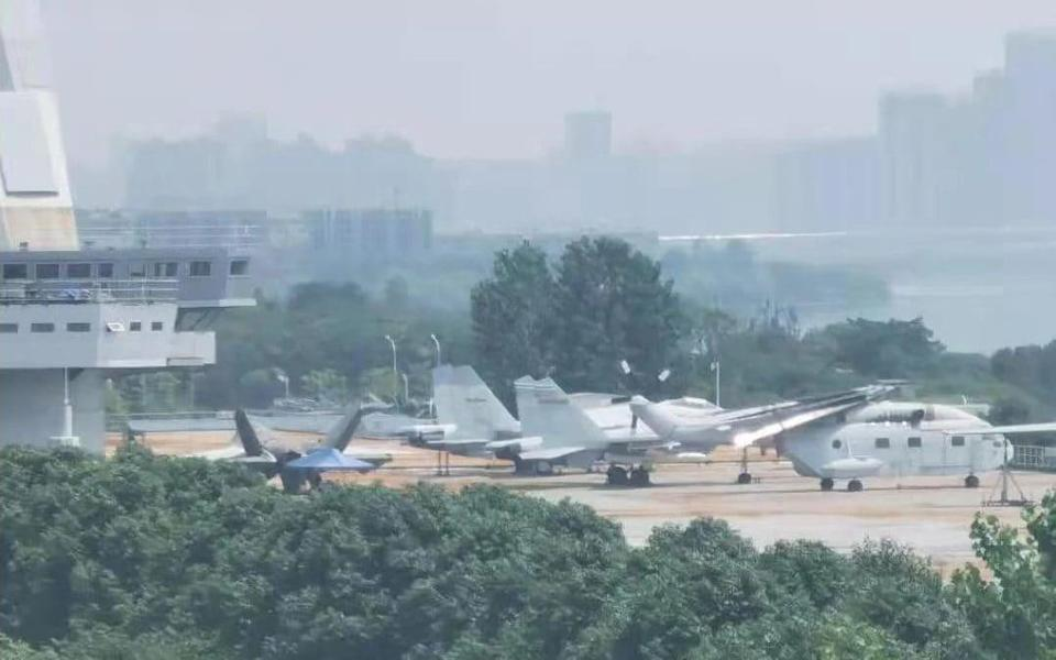 The jet was spotted parked alongside non-stealth J-15s and a Z-18 helicopter