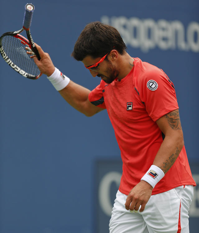Janko Tipsarevic of Serbia reacts after losing a point to Spain's David Ferrer in the quarterfinals during the 2012 US Open tennis tournament, Thursday, Sept. 6, 2012, in New York. (AP Photo/Julio Cortez)
