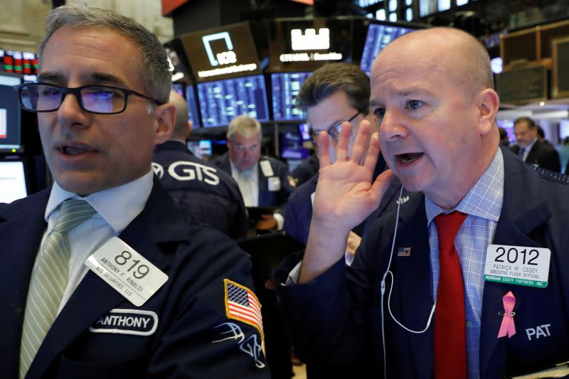 Bond yields slide to record lows, stocks succumb to virus fears