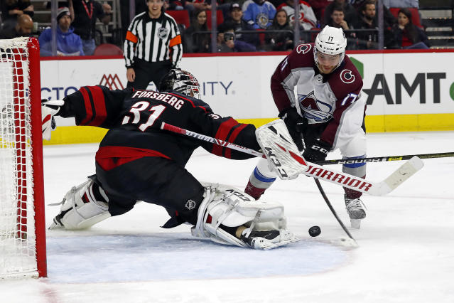 Colorado Avalanche's Tyson Jost (17) grabs a rebound off the pad of Carolina Hurricanes goaltender Anton Forsberg (31), of Sweden, for a goal during the second period of an NHL hockey game in Raleigh, N.C., Friday, Feb. 28, 2020. (AP Photo/Karl B DeBlaker)