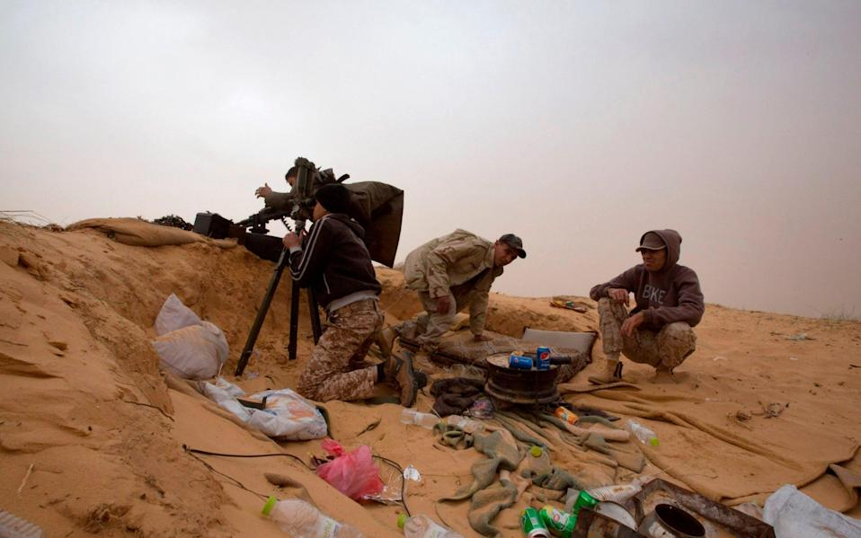 Two armies have been warring in Libya - AP Photo/Mohamed Ben Khalifa, File