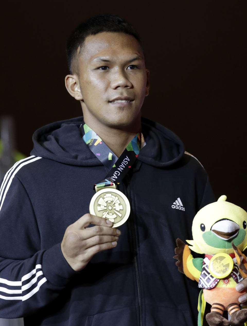 Men's middleweight bronze medalist Phillippines' Eumir Felix Marcial stands on the podium at the 18th Asian Games in Jakarta, Indonesia, Saturday, Sept. 1, 2018. (AP Photo/Lee Jin-man)