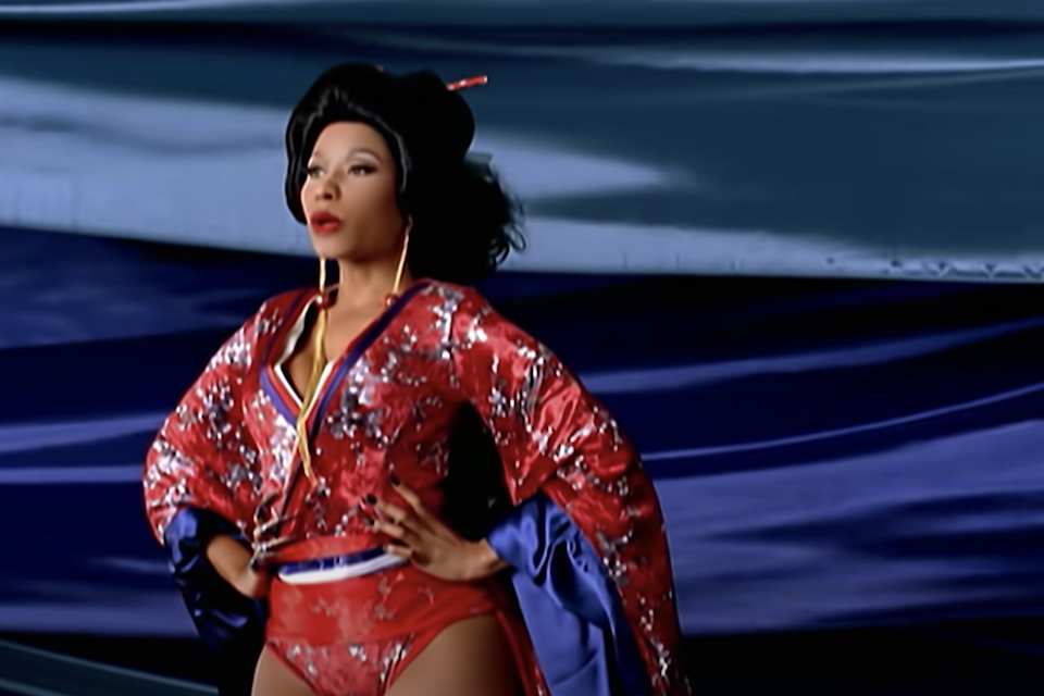Nicki with her hands on her hips in the Your Love music video