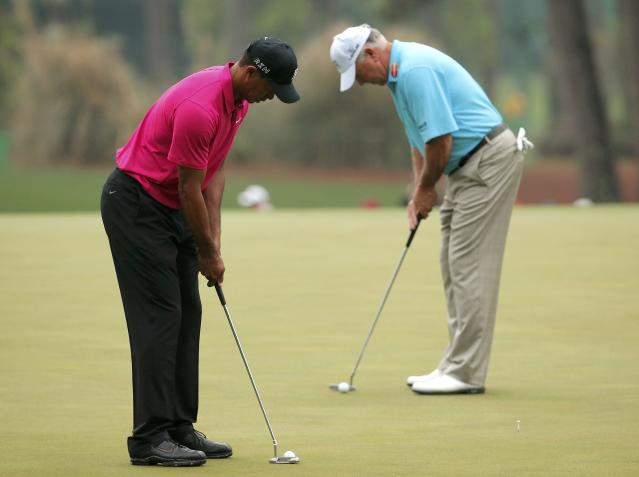 Woods of the U.S. and compatriot O'Meara putt on the third green during their practice round ahead of the 2015 Masters at the Augusta National Golf Course in Augusta