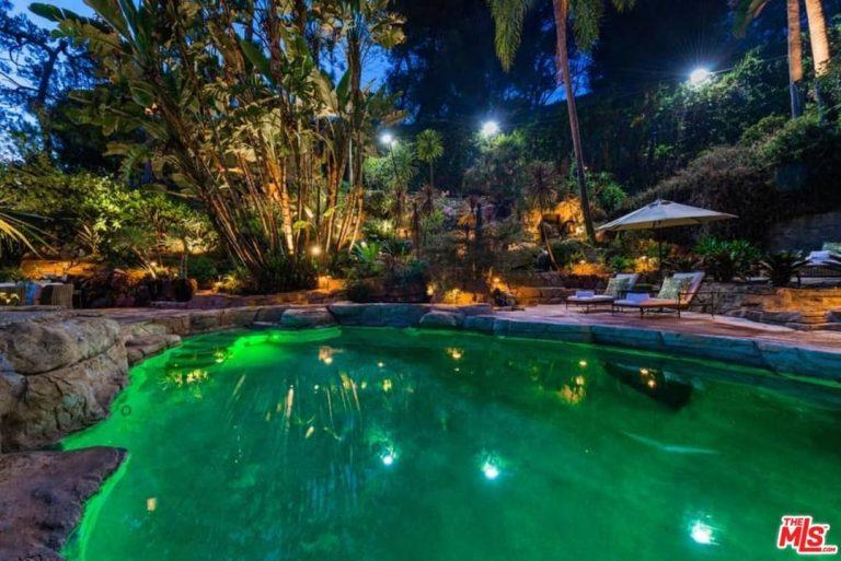 The pool area features plenty of lighting. (Photo: The MLS via Trulia)