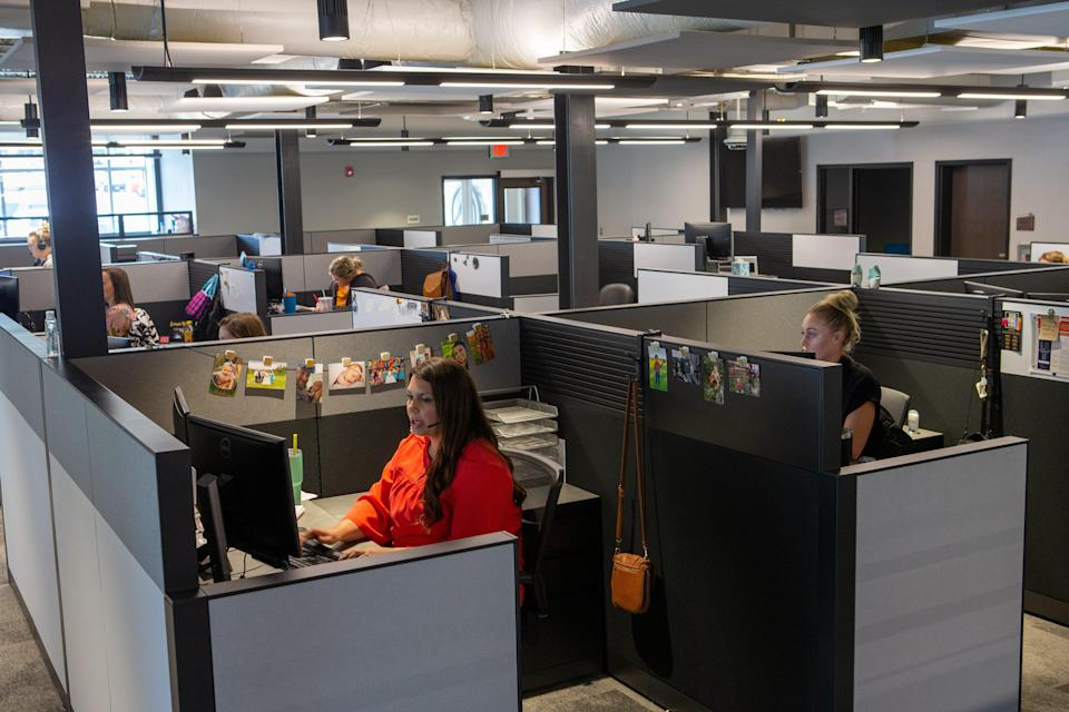 Advisors Excel employees work in cubicles inside the new Professional Building at 4125 SW Gage Center Drive Tuesday morning.