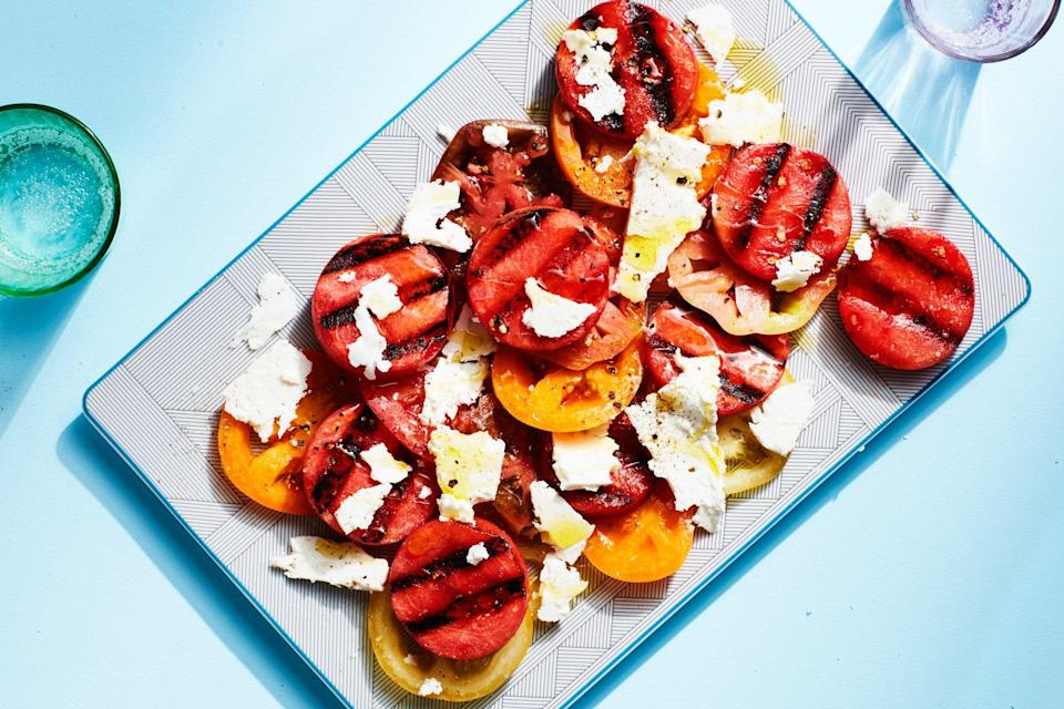 """Grilling the watermelon adds a savory depth to the fruit, giving this refreshing summer salad much more flavor than you'd imagine from this simple combination. <a href=""""https://www.epicurious.com/recipes/food/views/3-ingredient-grilled-watermelon-feta-and-tomato-salad?mbid=synd_yahoo_rss"""" rel=""""nofollow noopener"""" target=""""_blank"""" data-ylk=""""slk:See recipe."""" class=""""link rapid-noclick-resp"""">See recipe.</a>"""
