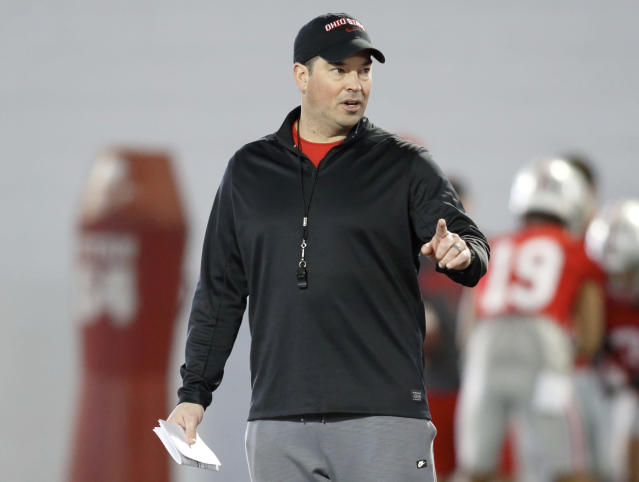 FILE - In this Wednesday, March 6, 2019 file photo, Ohio State NCAA college football head coach Ryan Day gestures during football practice in Columbus, Ohio. New Ohio State coach Ryan Days 10 assistant coaches will be paid a total of more than $7.4 million this year. Contracts of the assistants were released by Ohio State on Monday, March 11, 2019. Co-defensive coordinator Greg Mattison tops the list at $1.1 million. (AP Photo/Paul Vernon, File)
