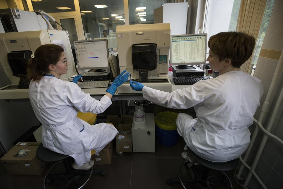 FILE - In this May 24, 2016 file photo, employees work in Russia's national drug-testing laboratory in Moscow, Russia. Russia is accused of manipulating an archive of doping data from a laboratory in Moscow, which was meant to be a peace offering to the World Anti-Doping Agency to solve earlier disputes. (AP Photo/Alexander Zemlianichenko, File)