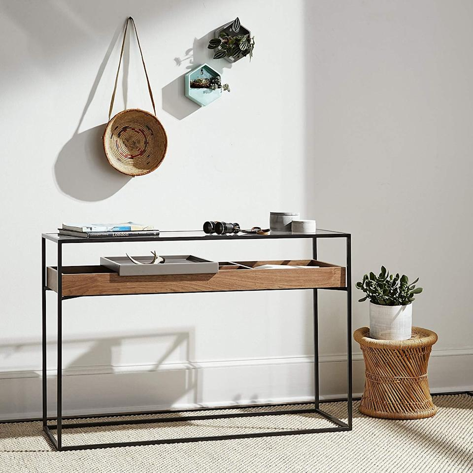 "<p>In an effort to clean up clutter, get this <a href=""https://www.popsugar.com/buy/Rivet-King-Street-Industrial-Cabinet-Media-Console-Table-406982?p_name=Rivet%20King%20Street%20Industrial%20Cabinet%20Media%20Console%20Table&retailer=amazon.com&pid=406982&price=203&evar1=casa%3Aus&evar9=45885220&evar98=https%3A%2F%2Fwww.popsugar.com%2Fhome%2Fphoto-gallery%2F45885220%2Fimage%2F45885289%2FRivet-King-Street-Industrial-Cabinet-Media-Console-Table&list1=shopping%2Chome%20decor%2Cfurniture%2Ceditors%20pick%2Chome%20improvement%2Csmall%20space%20living%2Caffordable%20decor%2Chome%20shopping&prop13=mobile&pdata=1"" rel=""nofollow"" data-shoppable-link=""1"" target=""_blank"" class=""ga-track"" data-ga-category=""Related"" data-ga-label=""https://www.amazon.com/Rivet-Industrial-Cabinet-Console-Functional/dp/B072ZNMKGM/ref=pd_sim_196_2?_encoding=UTF8&amp;pd_rd_i=B072ZNMKGM&amp;pd_rd_r=802a91be-1d0b-11e9-abf5-511f91f0b0a7&amp;pd_rd_w=xtA4k&amp;pd_rd_wg=rLHJ0&amp;pf_rd_p=18bb0b78-4200-49b9-ac91-f141d61a1780&amp;pf_rd_r=Z795N607QTC0PR9A9YD8&amp;psc=1&amp;refRID=Z795N607QTC0PR9A9YD8"" data-ga-action=""In-Line Links"">Rivet King Street Industrial Cabinet Media Console Table</a> ($203) for storing keys and more in your entryway.</p>"