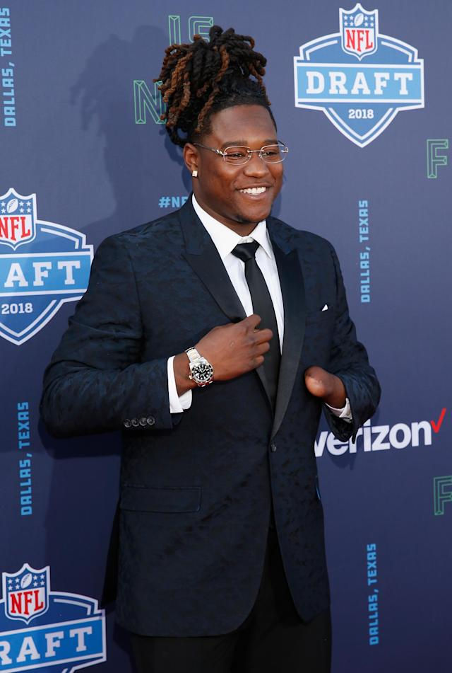 <p>Shaquem Griffin of UCF poses on the red carpet prior to the start of the 2018 NFL Draft at AT&T Stadium on April 26, 2018 in Arlington, Texas. (Photo by Tim Warner/Getty Images) </p>