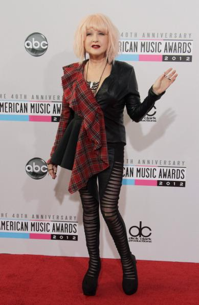 Cyndi Lauper arrives on the 2012 American Music Awards red carpet.