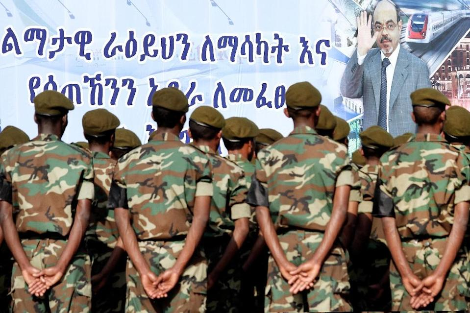 Ethiopian soldiers take part to the official state funeral of Ethiopia's late Prime Minister Meles Zenawi under a giant poster of late strongman in Addis Ababa on September 2, 2012 (AFP Photo/Mulugeta Ayene)